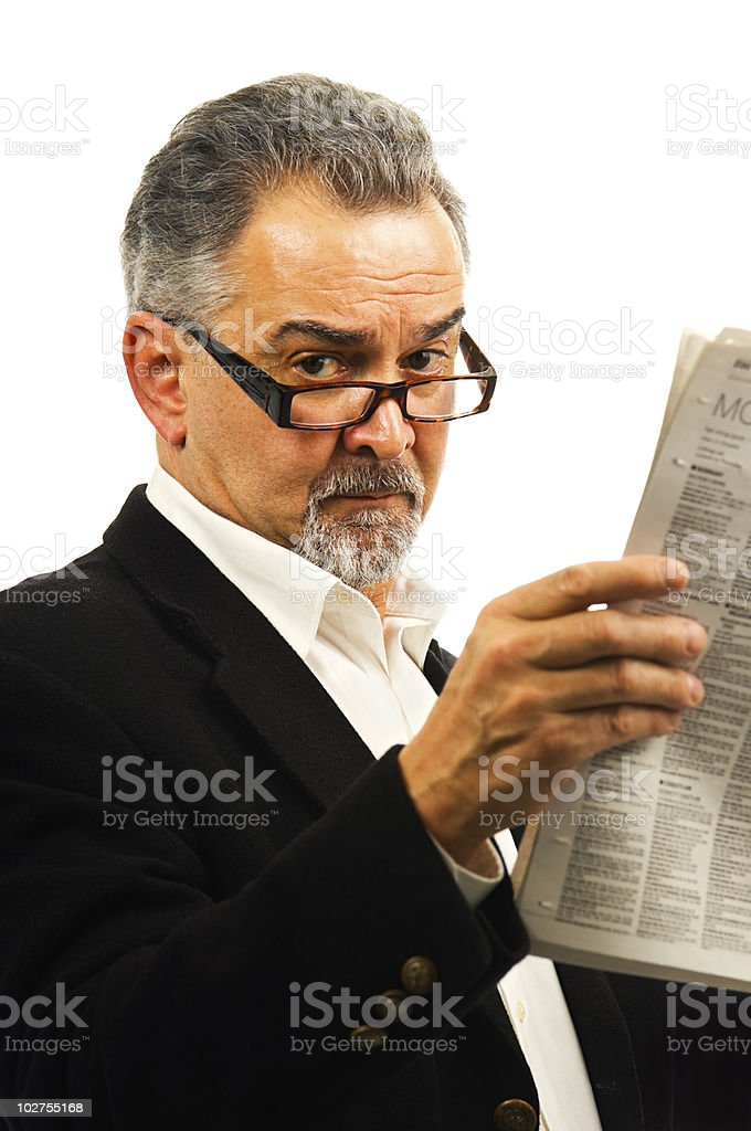 Businessman reads his newspaper. royalty-free stock photo