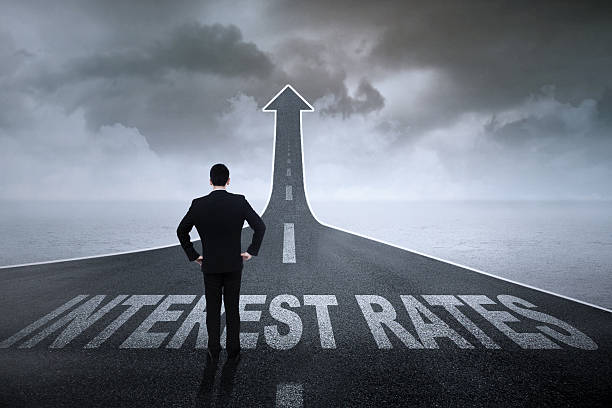 businessman ready for higher interest rates - interest rate stock photos and pictures