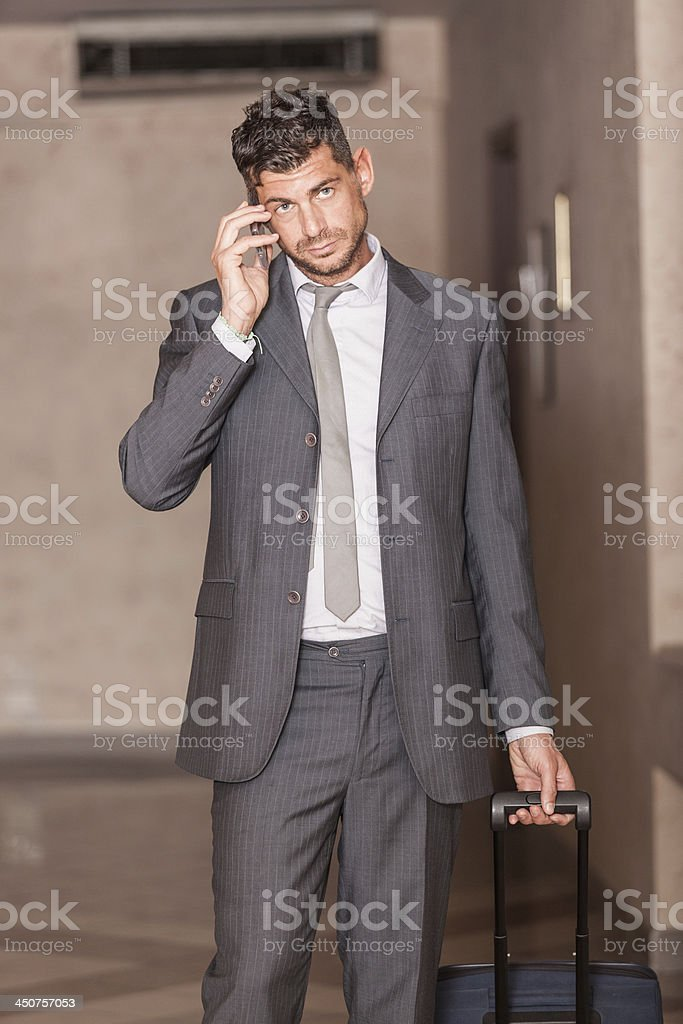 Businessman ready to Depart with Trolley stock photo