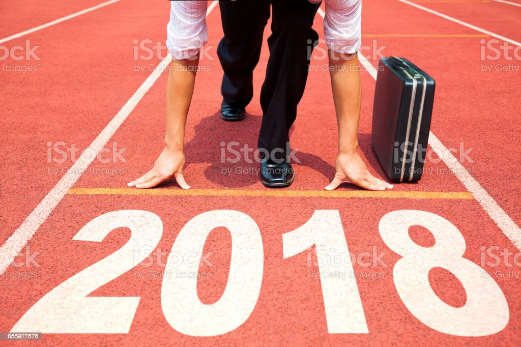 businessman ready to run and 2018 new year concept stock photo