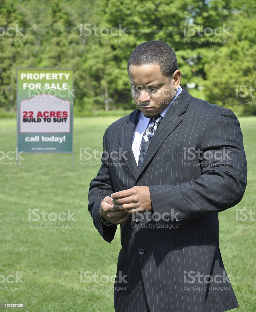 Businessman Real Estate Sign royalty-free stock photo
