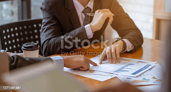 Businessman receive counseling from colleague, It is a picture of the working atmosphere of company employees in the office in the early 21st century.
