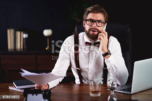 626916886istockphoto Businessman receiving bad news while phone call 878414812