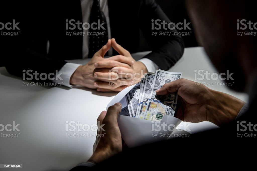 Businessman Receiving Money Us Dollars In The Envelope From