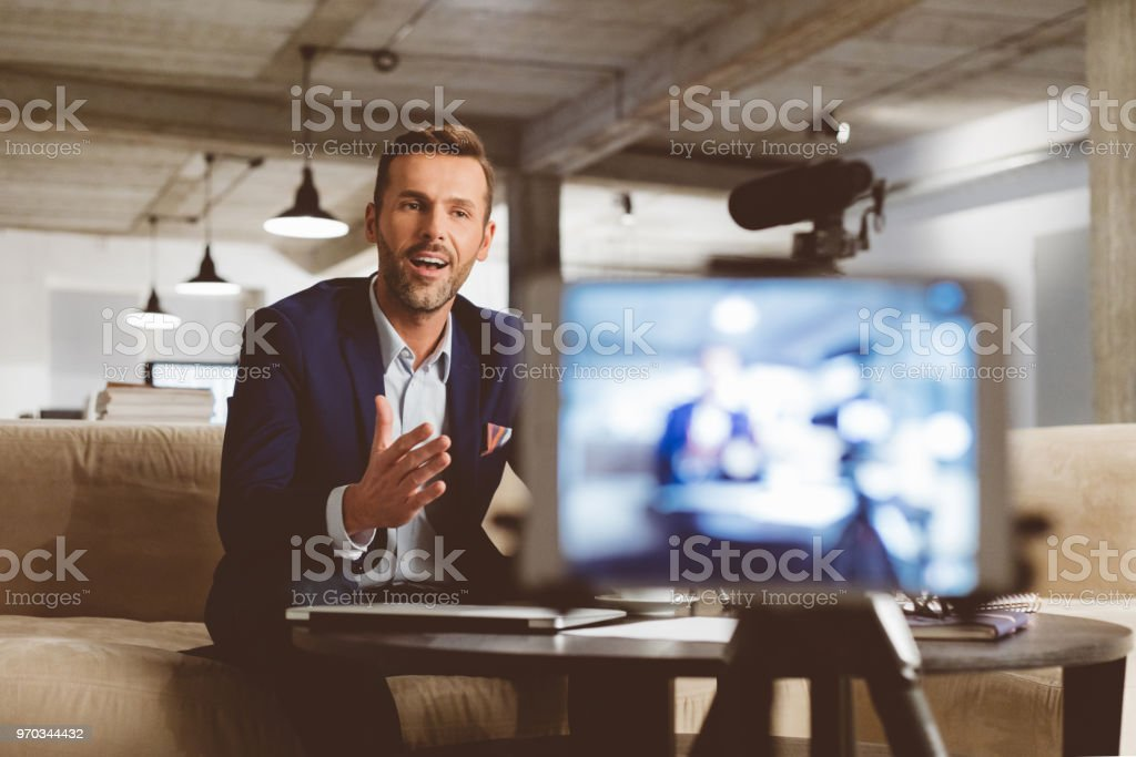 Businessman recording a video for this vlog stock photo
