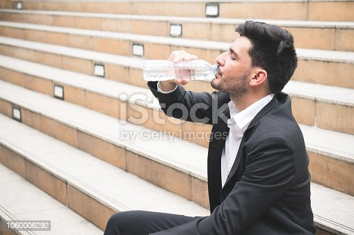 Businessman refresh by water bottle for health concept