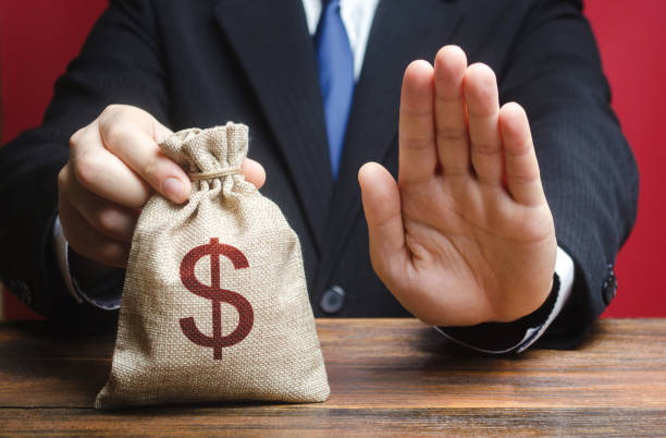 Businessman refuses to give a money bag. Refusal to grant loan mortgage, bad credit history. Refuses to cooperate. Economic sanctions, confiscation funds, deductions and fines. Financial difficulties Businessman refuses to give a money bag. Refusal to grant loan mortgage, bad credit history. Refuses to cooperate. Economic sanctions, confiscation funds, deductions and fines. Financial difficulties sanctions stock pictures, royalty-free photos & images