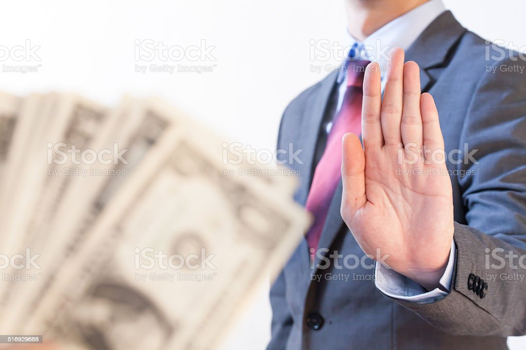 Businessman refuses to receive money stock photo