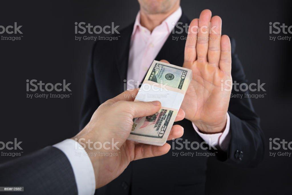 Businessman Refusing To Take A Bribe stock photo