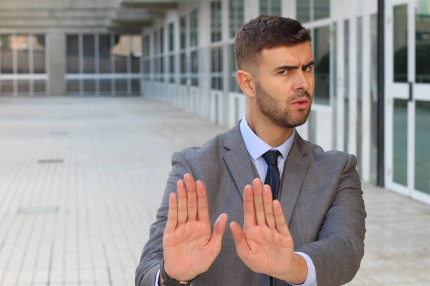 Businessman rejecting an inappropriate proposal stock photo