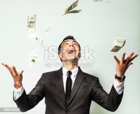 969671638istockphoto Businessman rejoicing for his success with hundred dollar bills. 185915049