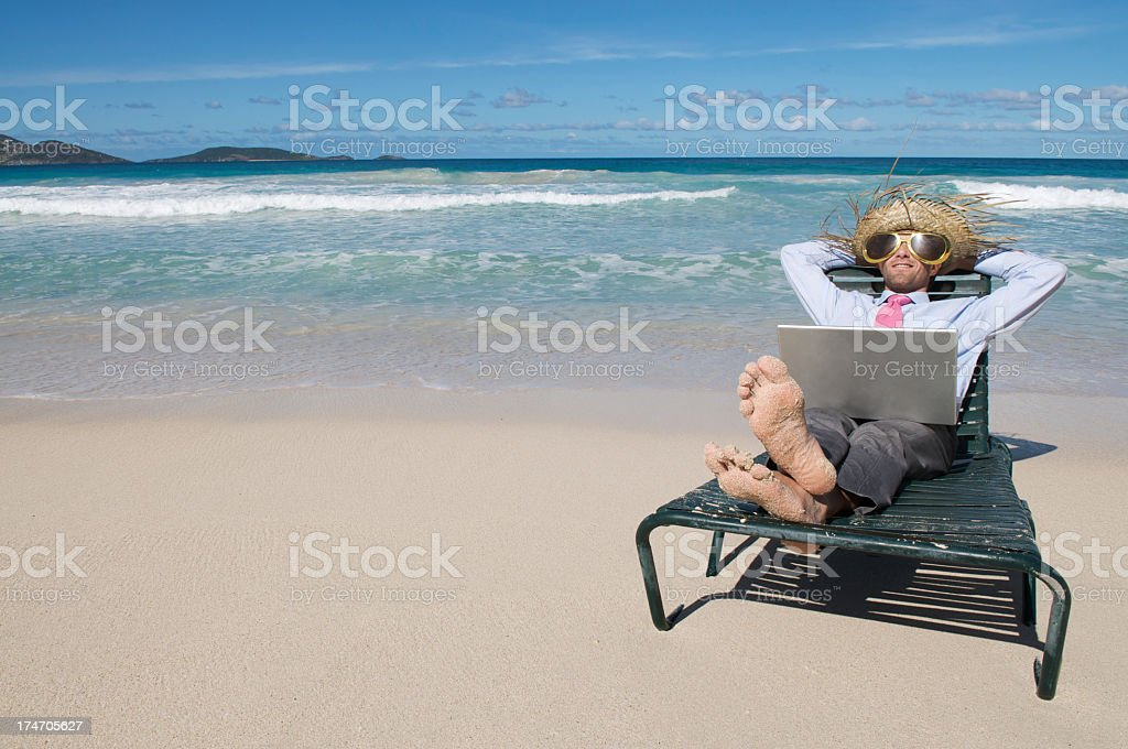 Businessman Relaxes on Beach w Laptop stock photo