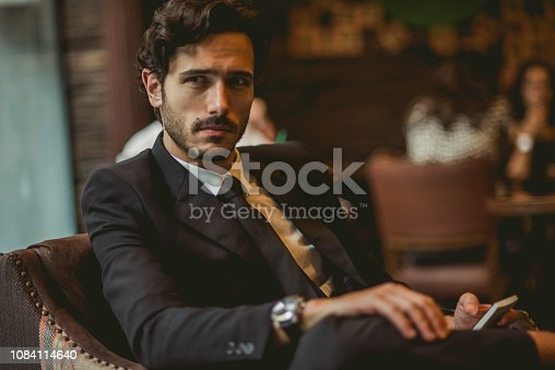 handsome man in suit relaxing after work