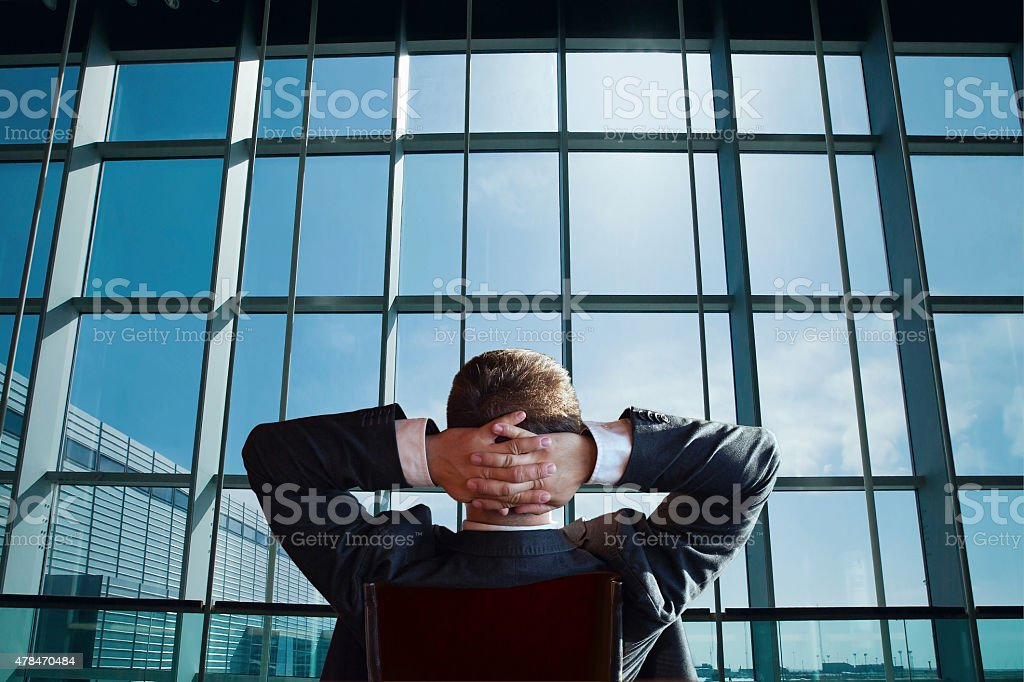 businessman relaxing and looking at the window stock photo