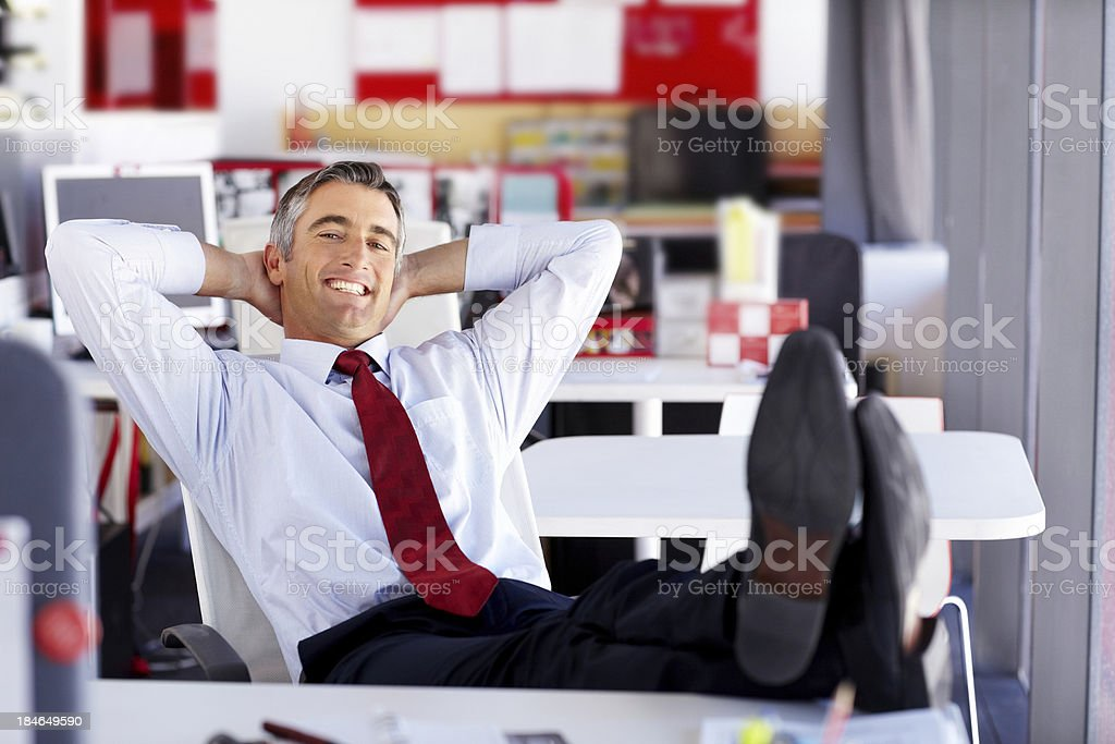 Businessman Relaxing at His Desk royalty-free stock photo