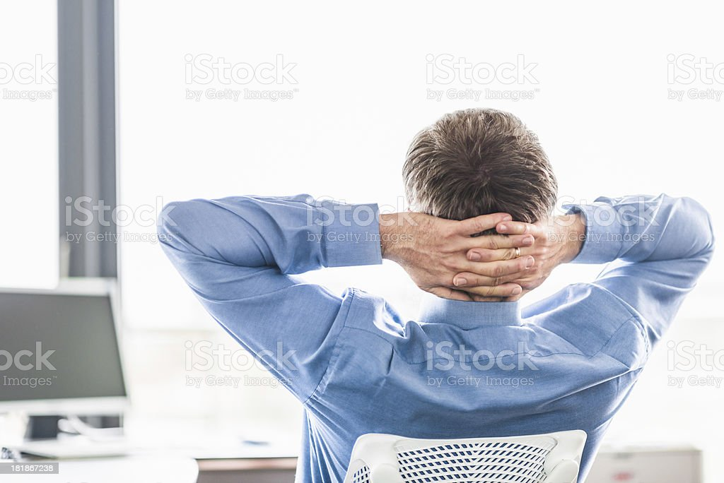 Businessman Relaxing in Office stock photo