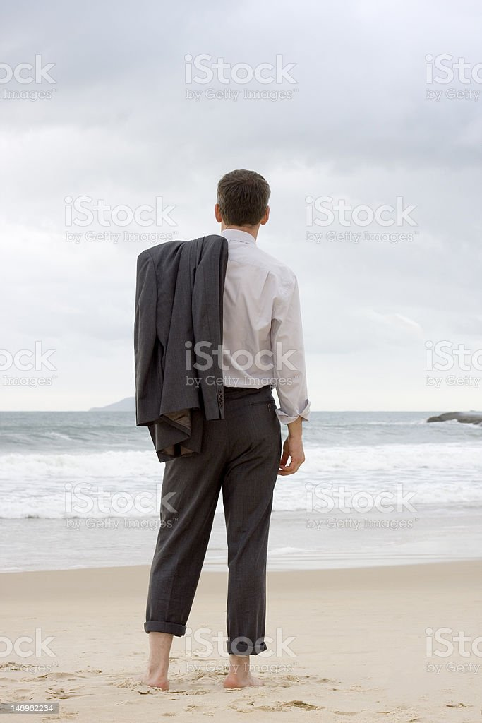 Businessman relaxing on a beach stock photo