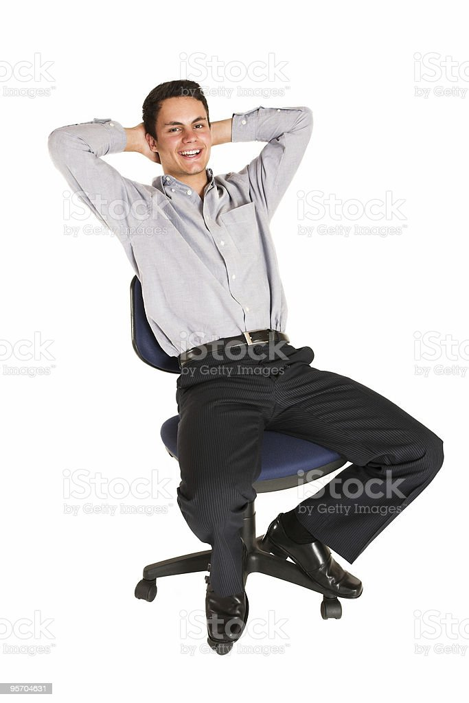 Businessman relaxing on chair stock photo