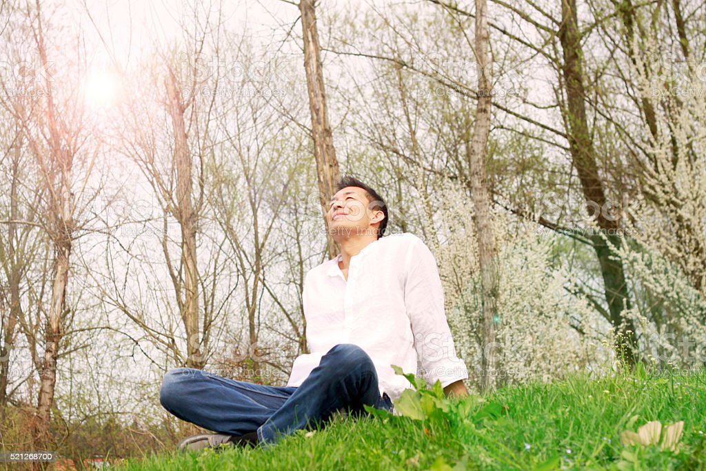 Businessman Relaxing on Grass stock photo