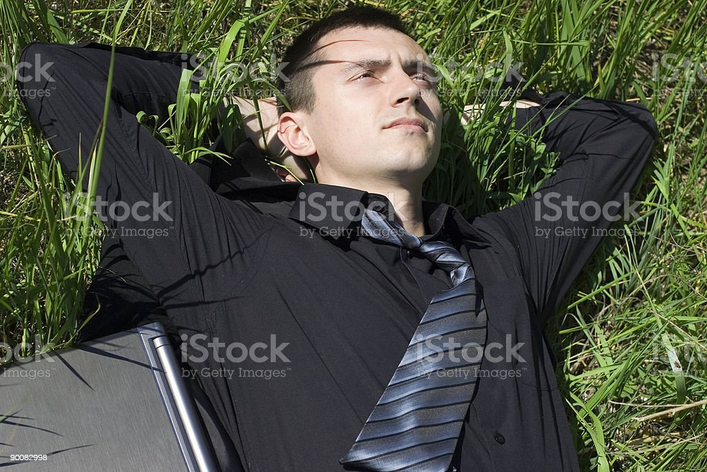 Businessman relaxing outdoors royalty-free stock photo