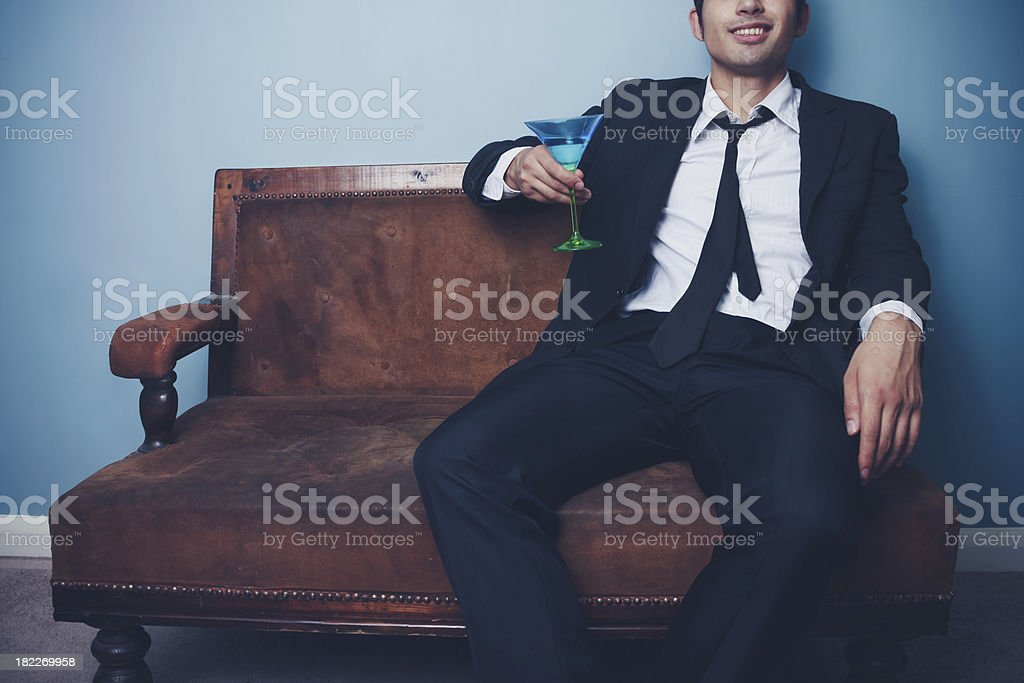 Businessman relaxing with a cocktail after work royalty-free stock photo