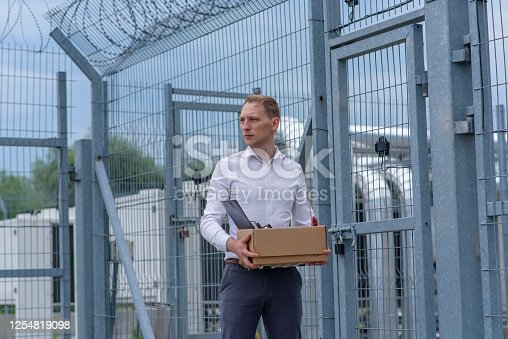 istock A businessman released from prison ponders what to do next. 1254819098