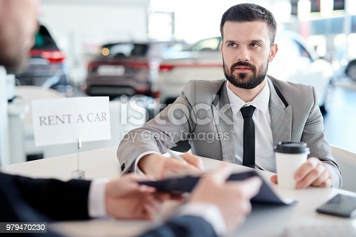 136591825istockphoto Businessman Renting Car 979470230