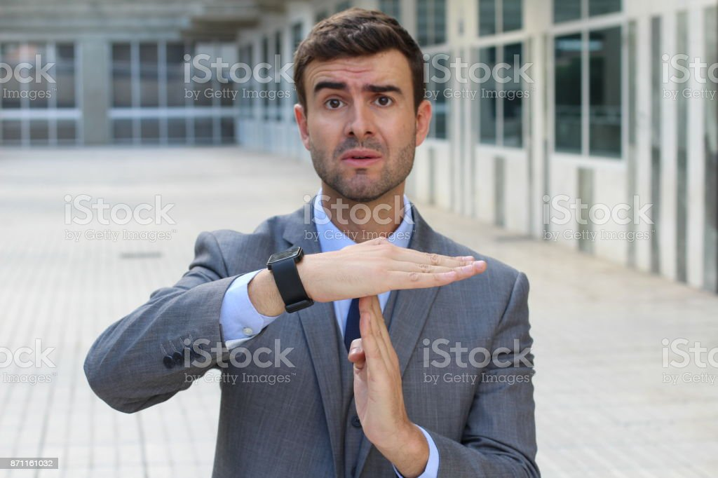 Businessman requesting a break with hands gesture stock photo