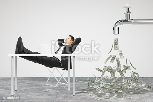 Businessman resting on a chair and faucet from which the money flow