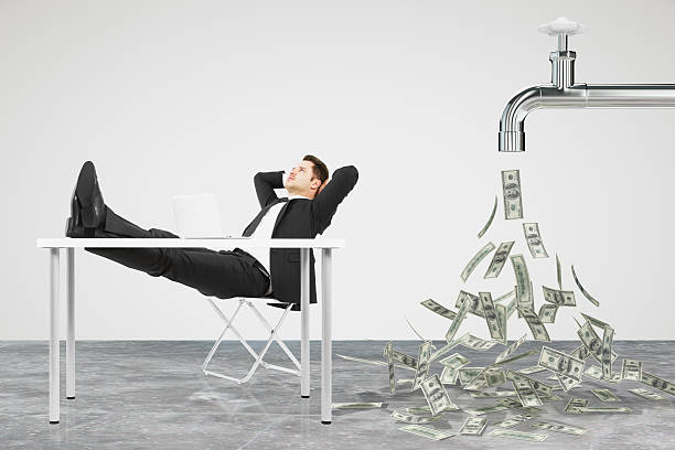Businessman resting on a chair and faucet from stock photo