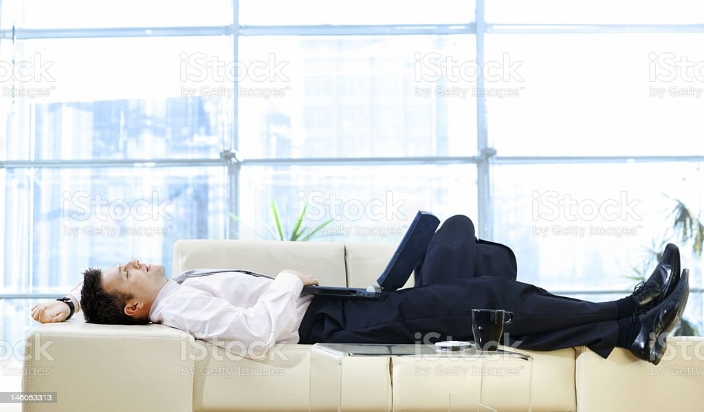 Businessman resting on sofa royalty-free stock photo