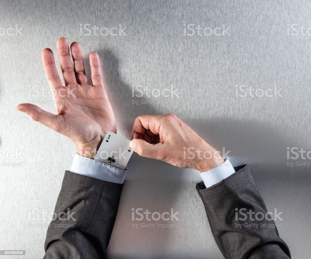 Businessman revealing a space ace card hidden in his sleeve stock photo