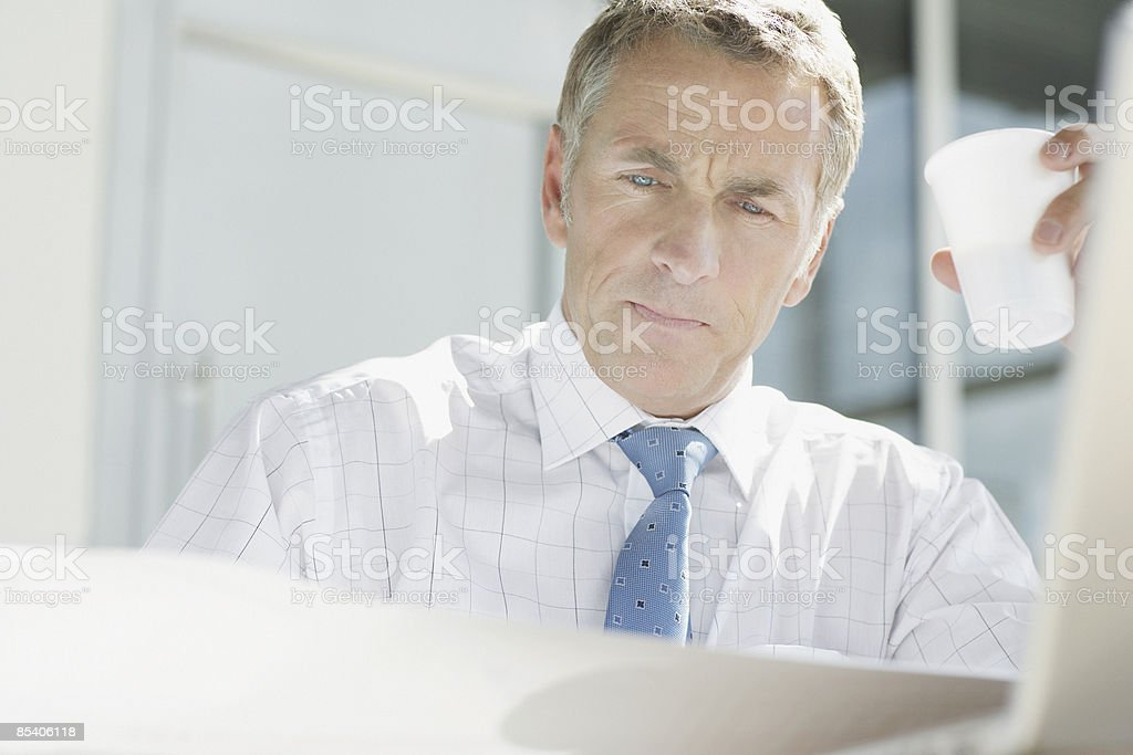 Businessman reviewing blueprints royalty-free stock photo