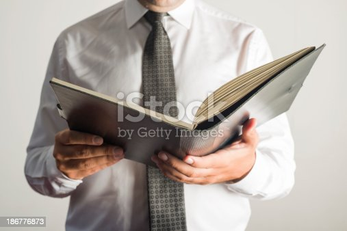 621728016istockphoto Businessman reviewing documents 186776873