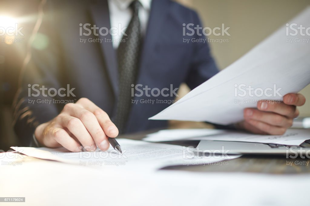 Businessman Reviewing Paperwork Closeup stock photo