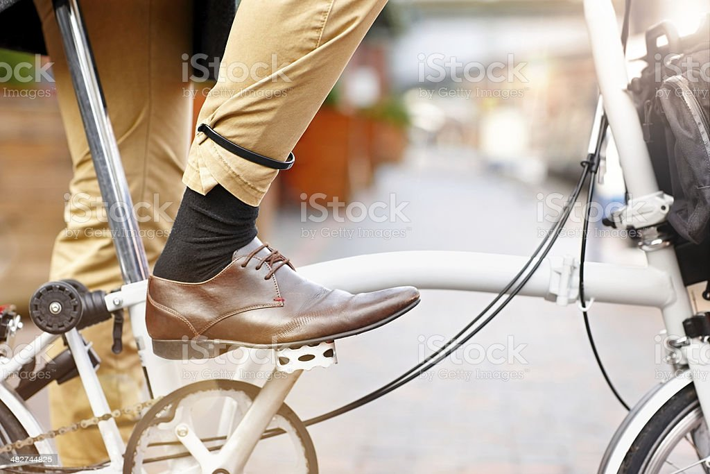 Businessman riding bicycle stock photo