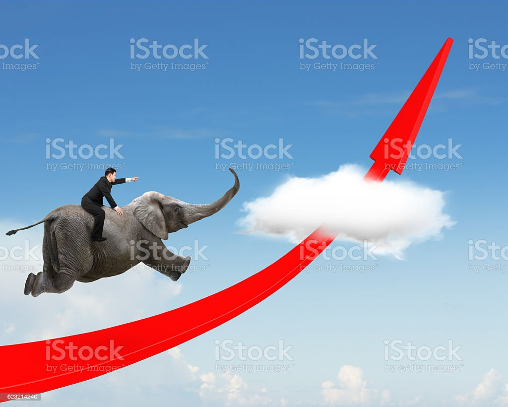 Businessman riding elephant on red arrow up trend line stock photo