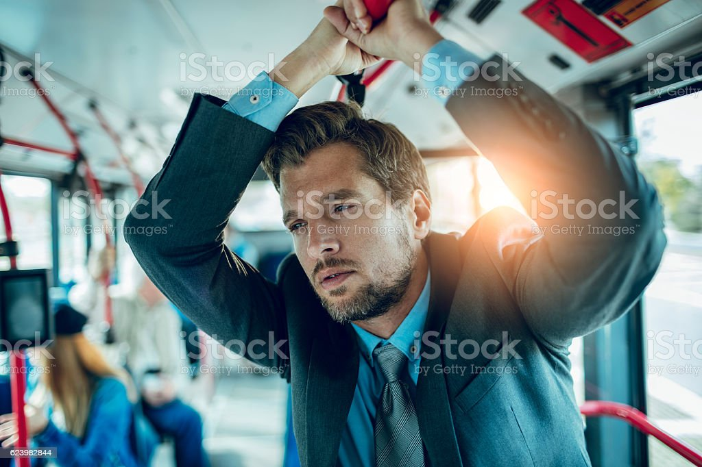 Businessman riding in a bus stock photo