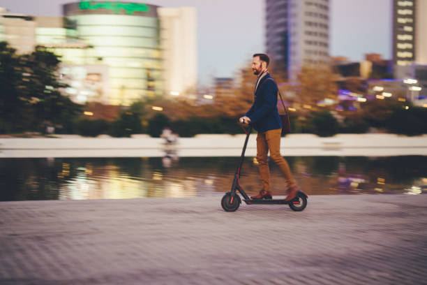 Businessman riding scooter in Spain stock photo