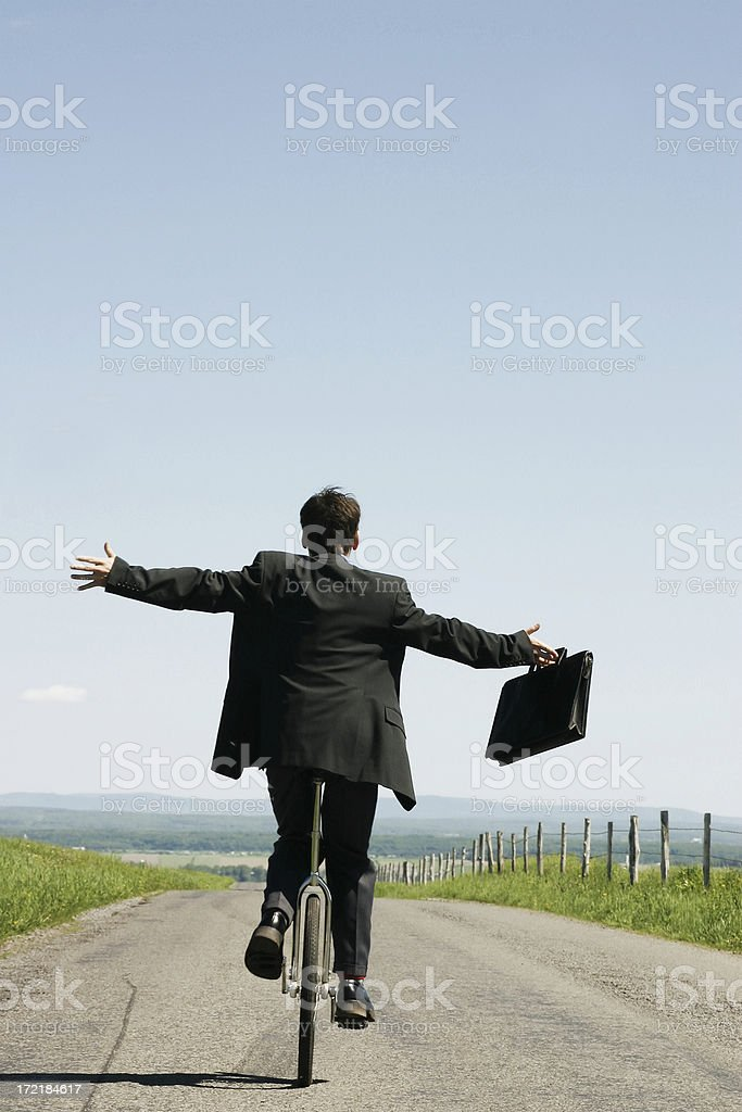 Businessman riding unicycle III royalty-free stock photo