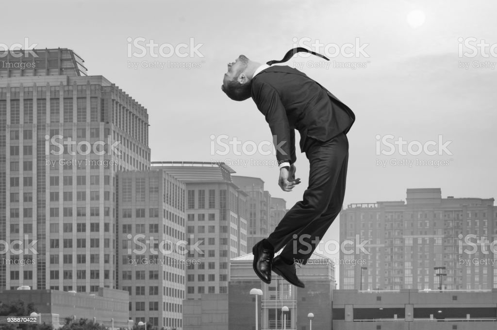 Businessman Rising and Falling stock photo