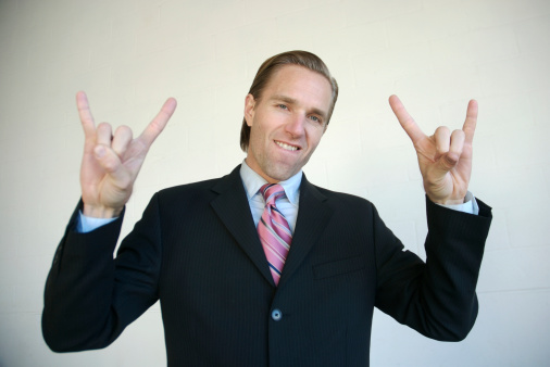 Businessman Rockin With Rock And Roll Sign White Background Stock Photo - Download Image Now