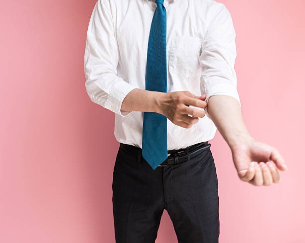 Businessman roll up his sleeves stock photo