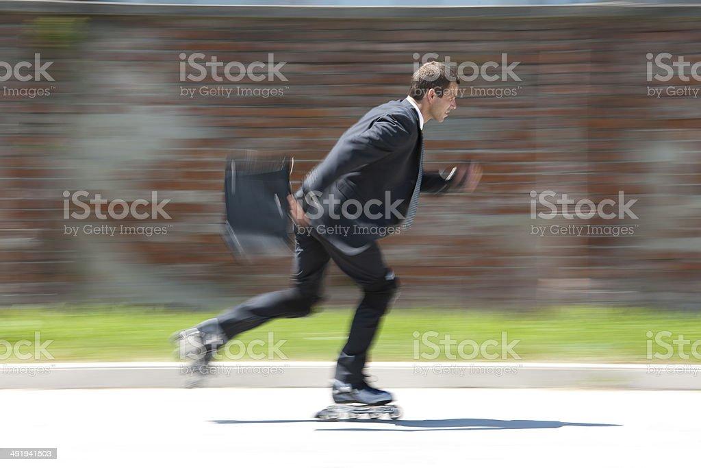 Businessman Rollerblading stock photo