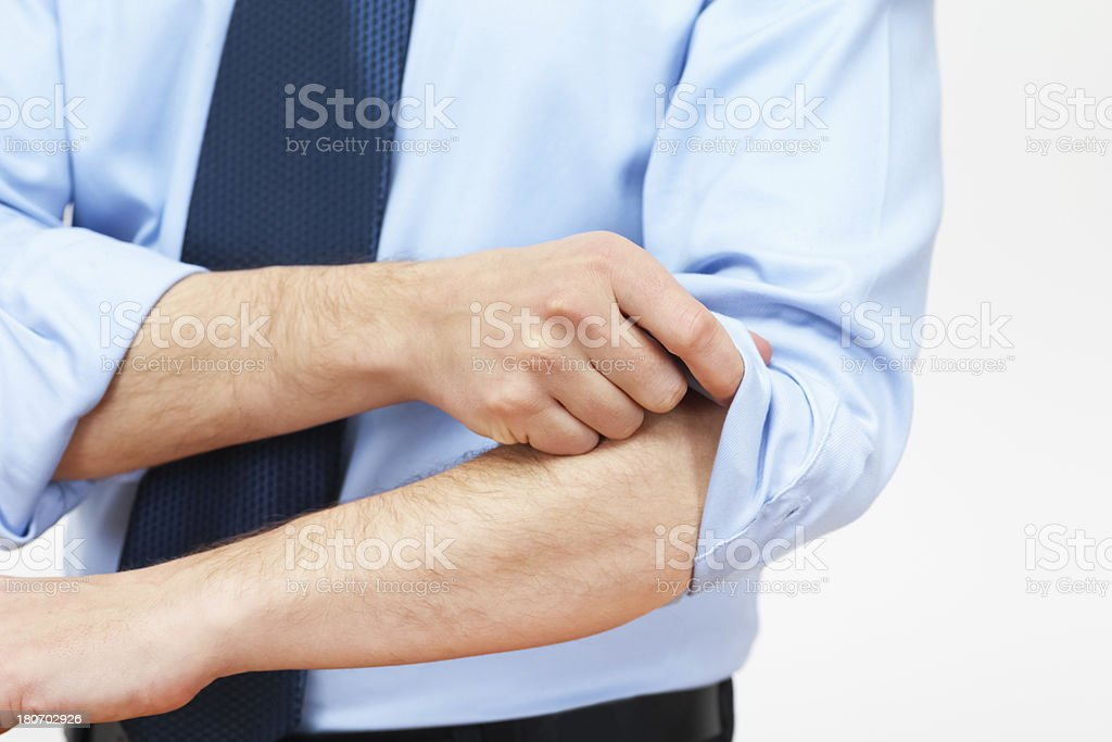 Businessman Rolling Up Sleeves stock photo