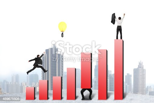 Businessman running and jumping on red bar chart, with one lifting, one cheered, one in lamp balloon, city background