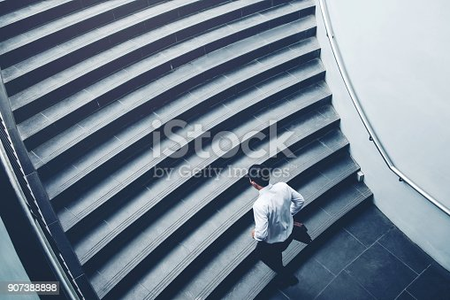 Businessman running fast upstairs Growth up Success concept