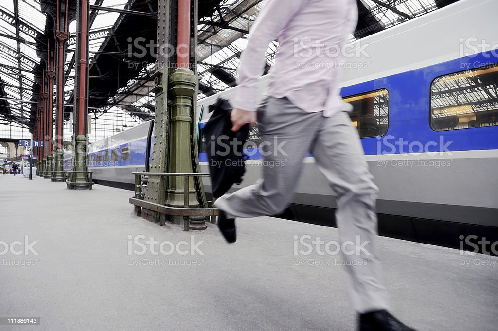 Businessman Running for Train royalty-free stock photo