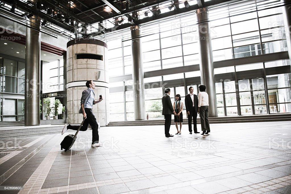 Businessman Running, Multi Ethnic Group Looking, Kyoto, Japan stock photo