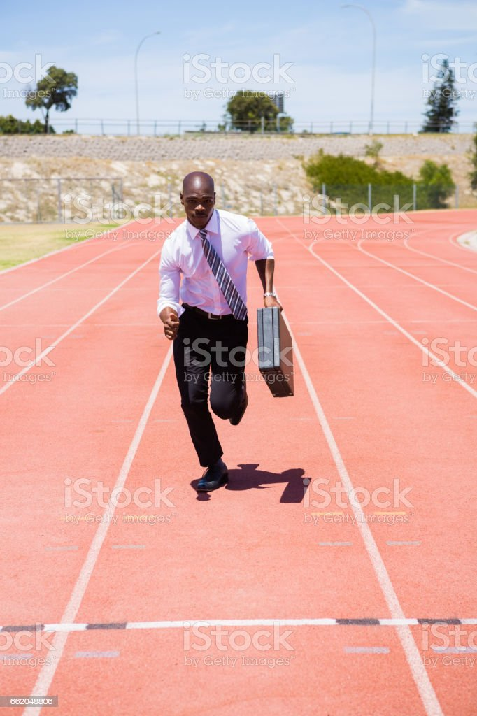 Businessman running on a running track royalty-free stock photo